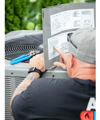 Always Ready Repair service professional is performing preventative maintenance on an air conditioning system in Tinley Park, IL