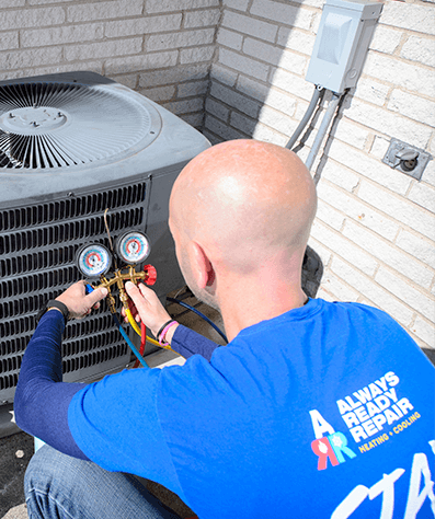 Always Ready Repair technician is charging an AC unit with refrigerant during a routine maintenance visit in home in Palos Park, IL