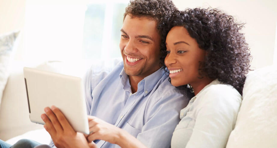 Young couple is applying for financing of their new HVAC system on Always Ready Repair website