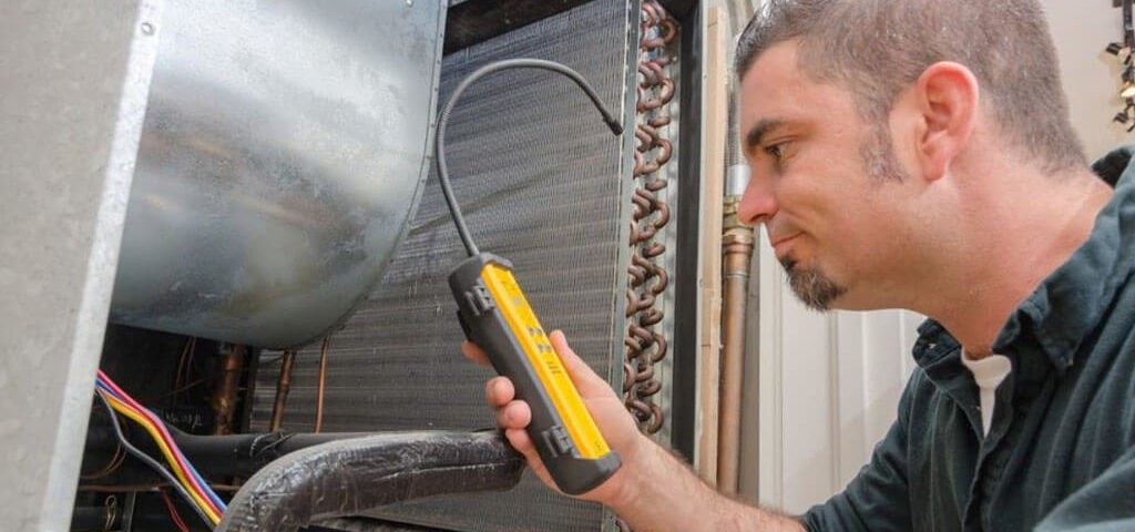 HVAC professional is performing evaporator coil repair in South Chicagoland Suburban home