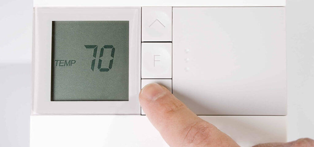 Always Ready Repair technician showing a homeowner the functions of a new digital thermostat